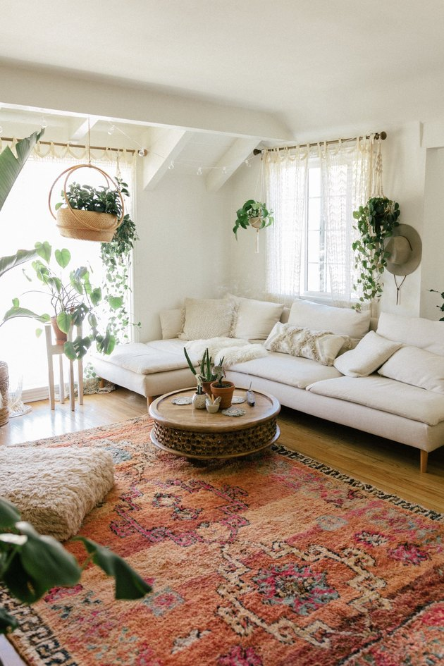 natural decor in white living room with bright red rug