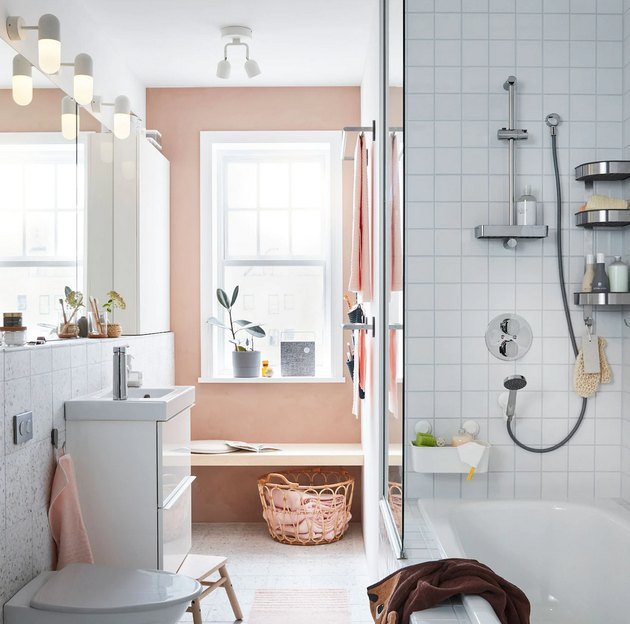 IKEA bathroom lighting idea with pink accent wall and white tile shower