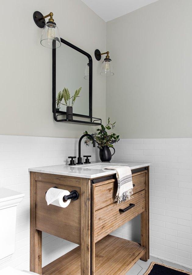 wooden sink in bright white bathroom