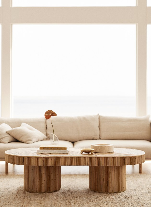natural decor with cream sofa with rattan coffee table