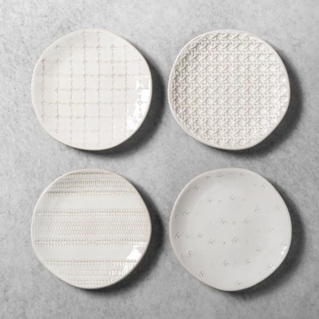 four small white plates