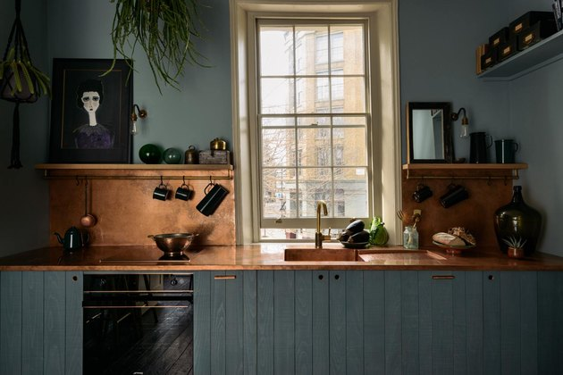 blue country kitchen with copper countertops by sebastian cox for devol
