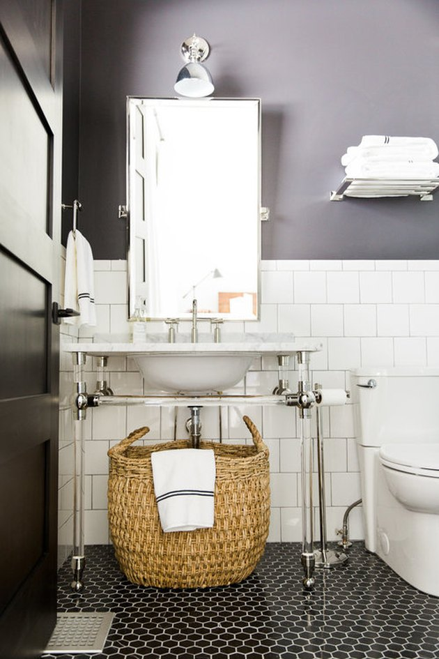 art deco bathroom by Studio McGee with black mosaic floor tile and console sink