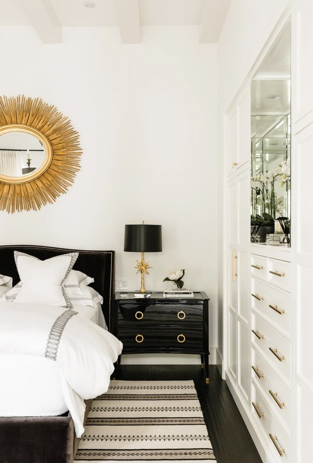 white bedroom with black lacquer furniture