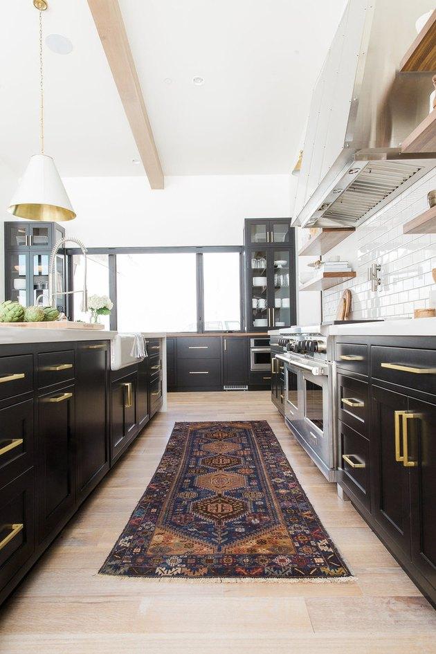 farmhouse-style kitchen with black island