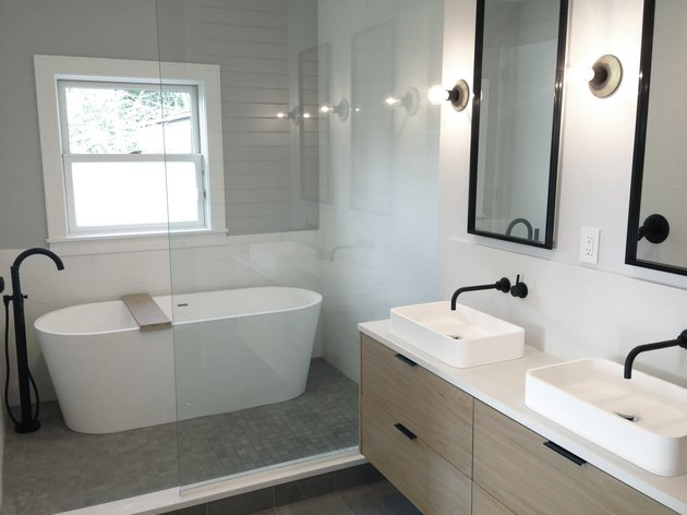 modern bathroom with rectangle mirrors over double vanity