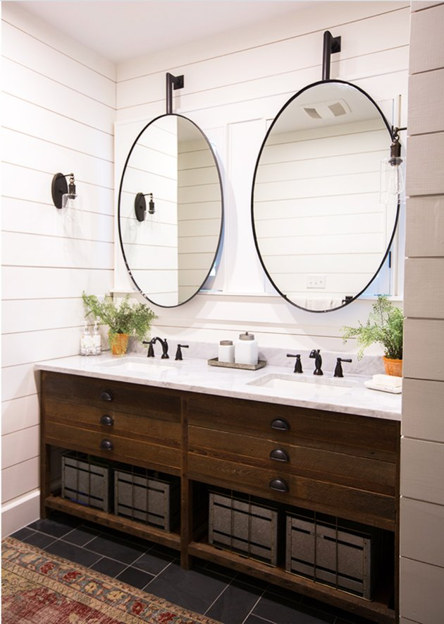bathroom with oval mirros over double vanity