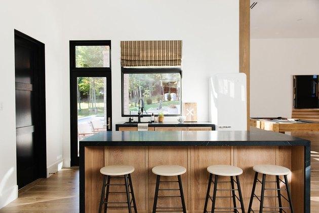 modern kitchen with black countertop island