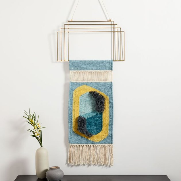 art deco woven artwork with gold metal detailing