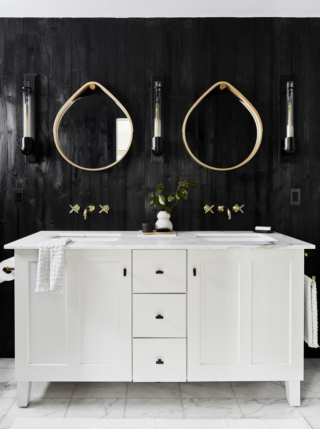 modern bathroom with teardrop mirrors over double vanity