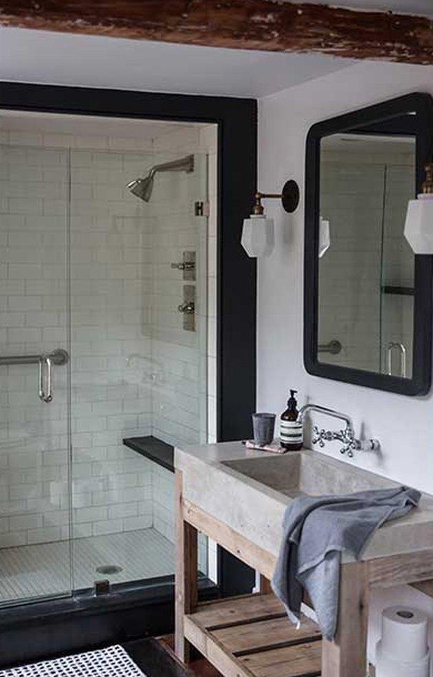 rustic bathroom lighting idea with milk glass wall sconces