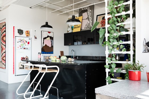 industrial style kitchen with black island