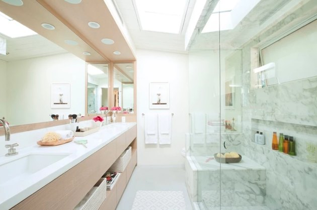 modern bathroom with full-wall mirrors over double vanity