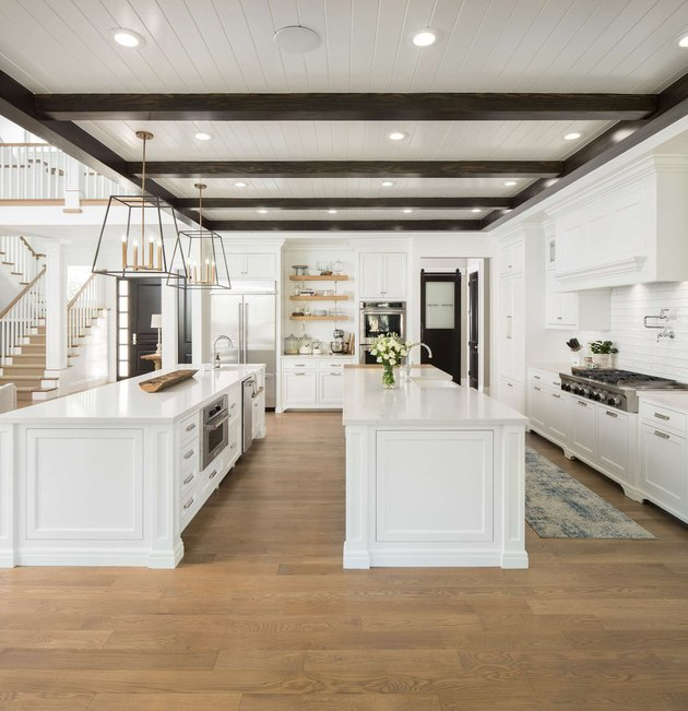 large open plan kitchen with double white island