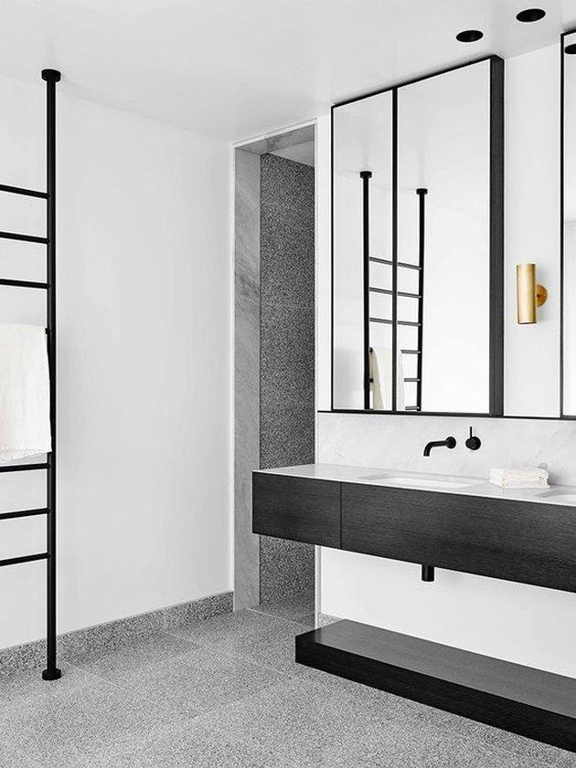 stone tile bathroom with terrazzo