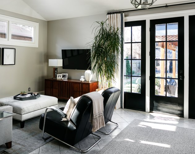 masculine family room ideas with TV with leather lounge chairs and ottoman