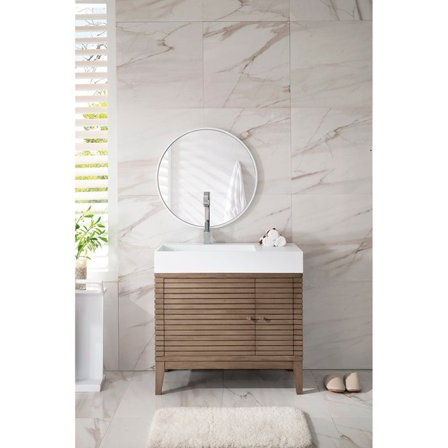 modern bathroom vanity with asymmetrical base