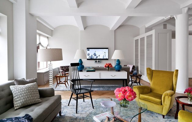 family room ideas with TV in sitting area with gold wingback chairs