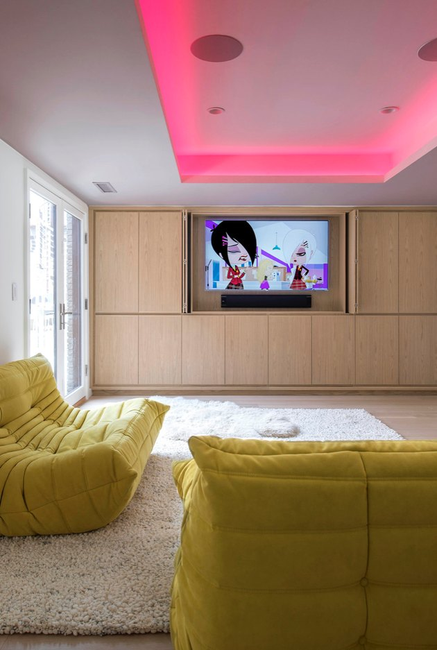 minimal family room ideas with TV and pink overhead lighting