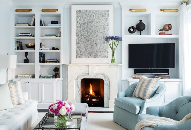 family room ideas with TV in space with blue upholstered chairs