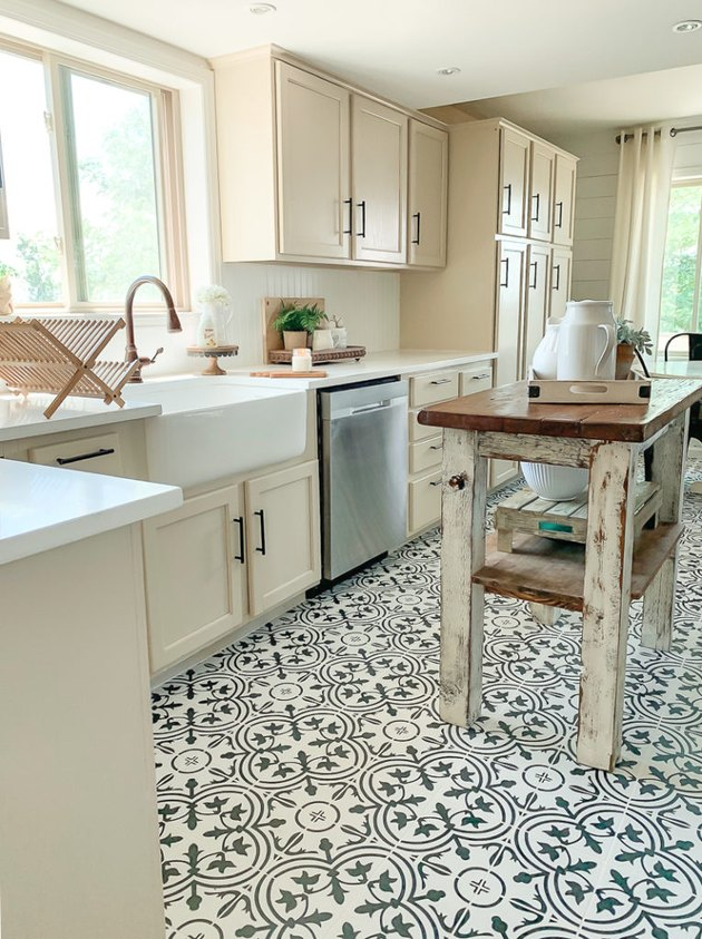 Black and white patterned cement tile farmhouse kitchen floor