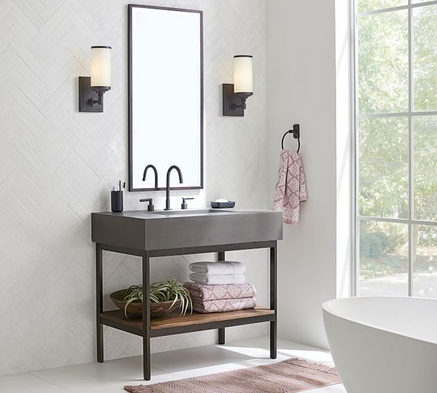 modern bathroom vanity with concrete top and open storage