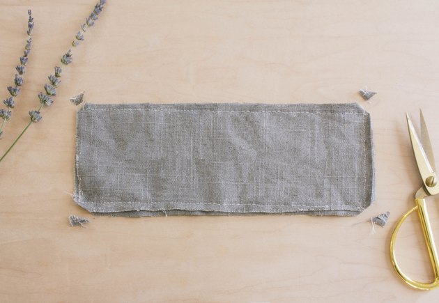 Corners clipped on gray linen eye pillow that's inside-out
