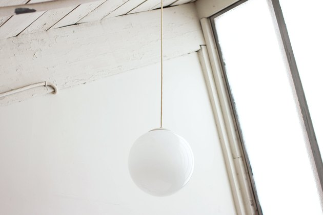 Ball-shaped midcentury pendant light