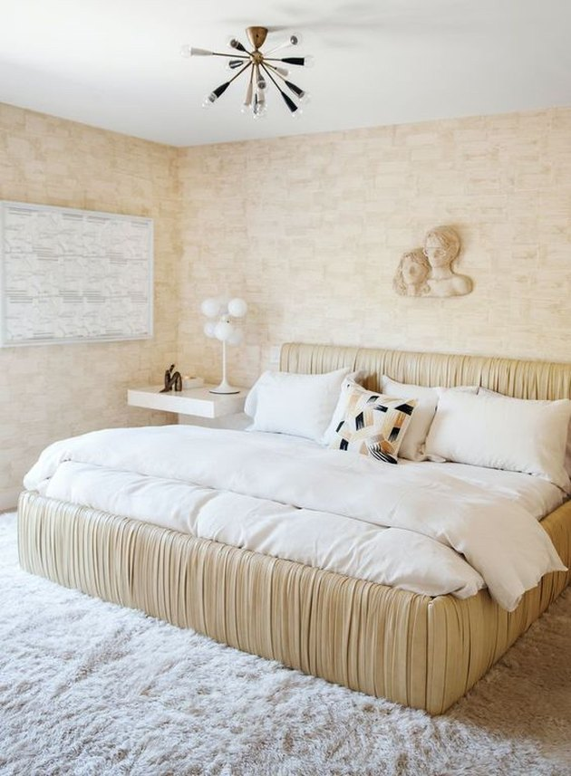 neutral art deco bedroom idea ruched leather bed