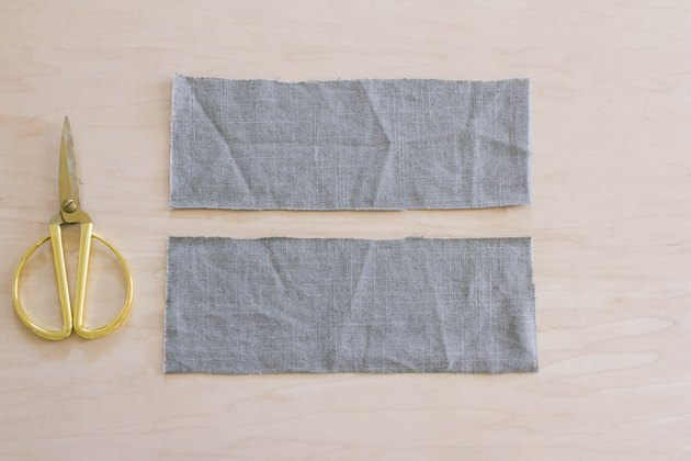 Two rectangles cut out of gray linen fabric