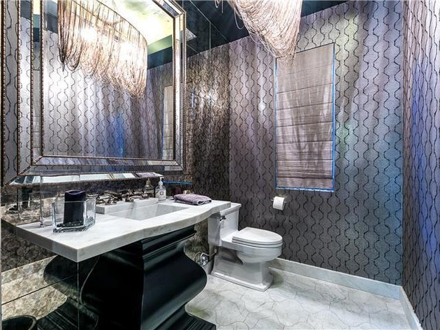 bathroom space with gray patterned walls