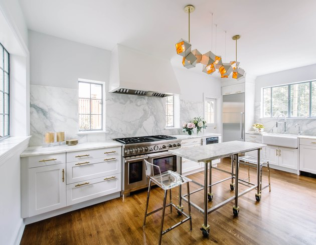 small stainless steel kitchen island with marble top