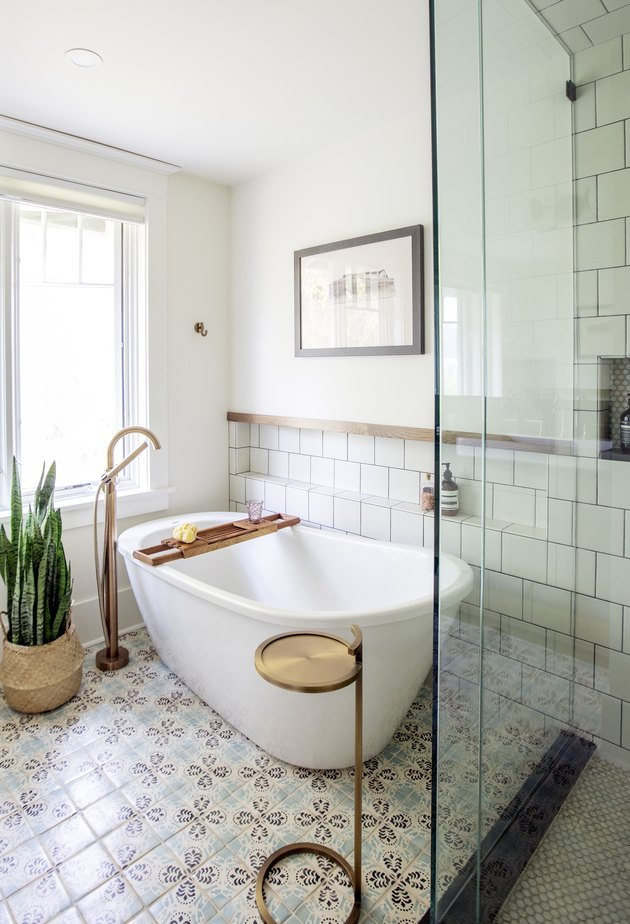 white bathtub on tiled floor
