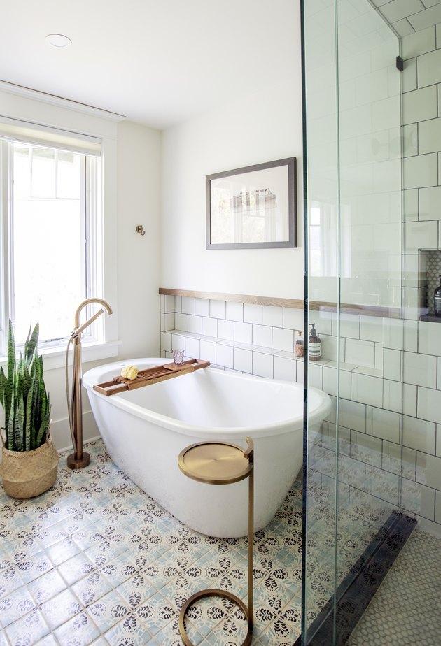 white bathtub on tiled floor