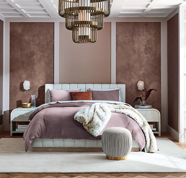 1920s bedroom with white upholstered bedframe
