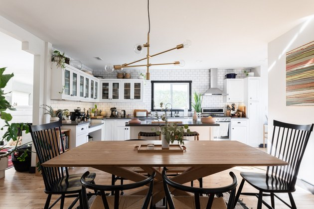 view of kitchen, kitchen island and kitchen table with decorative pendant light above