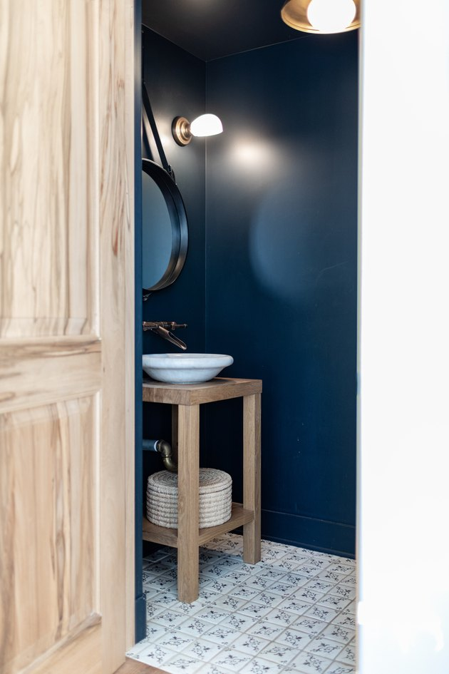 black powder room with wooden vanity