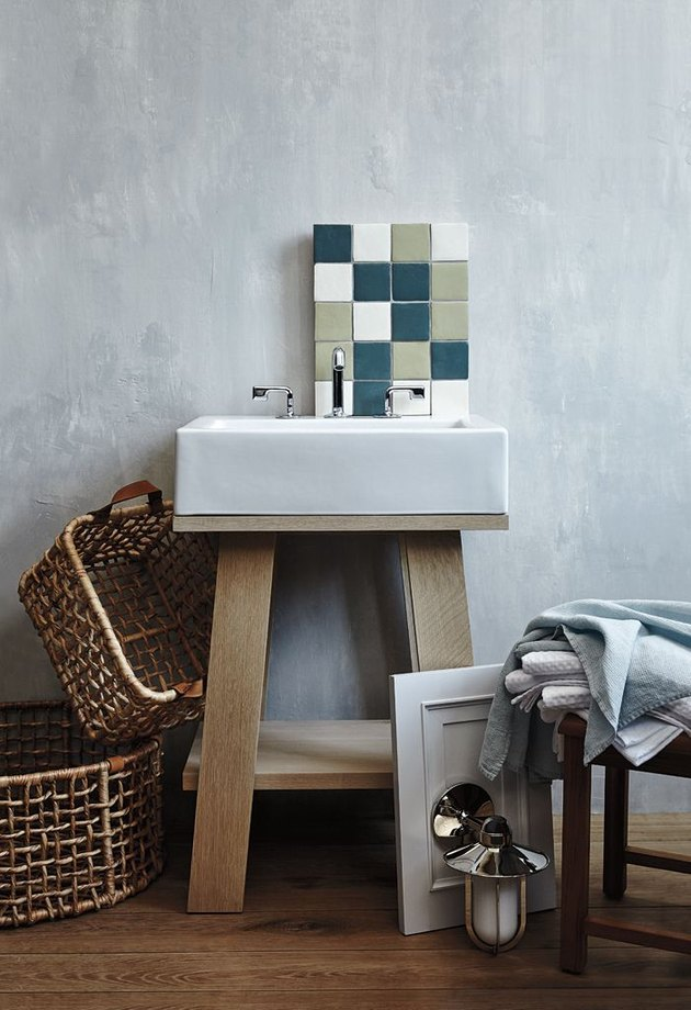 Scandinavian open bathroom vanity with wood base and chrome faucet