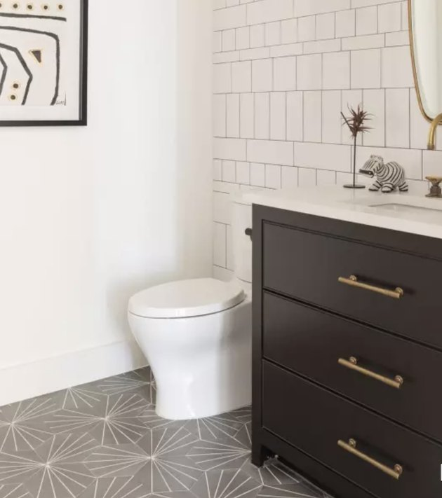 Gray starburst pattern cement tiles in bathroom