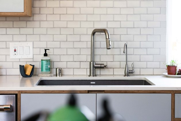 kitchen sink, white countertops, subway tile and garbage disposal