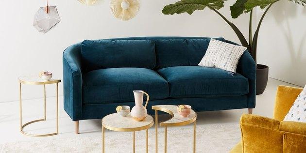 Curved blue velvet couch