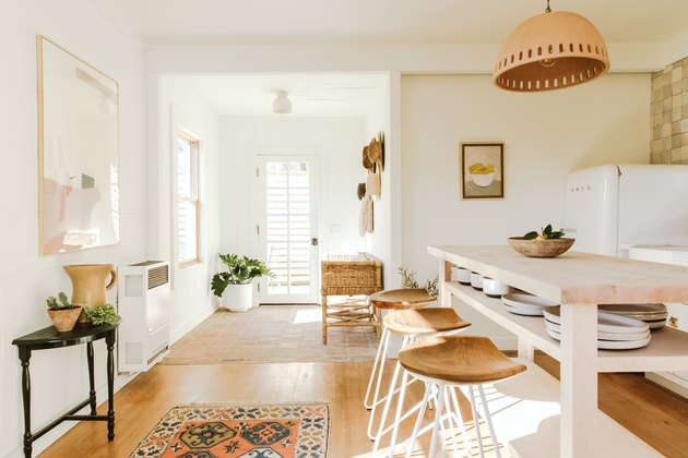 light wood kitchen island ideas for small kitchens with white walls and boho accents