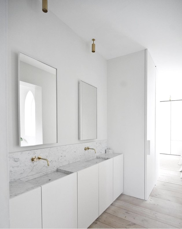 White minimalist bathrooms with brass fixtures