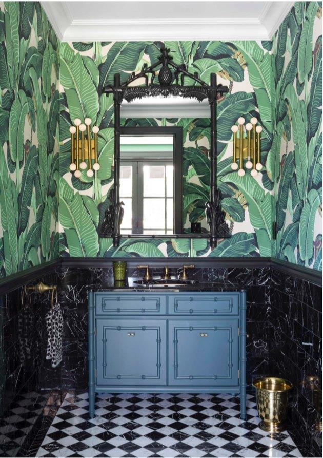hollywood regency bathroom with banana leaf wallpaper and bamboo vanity