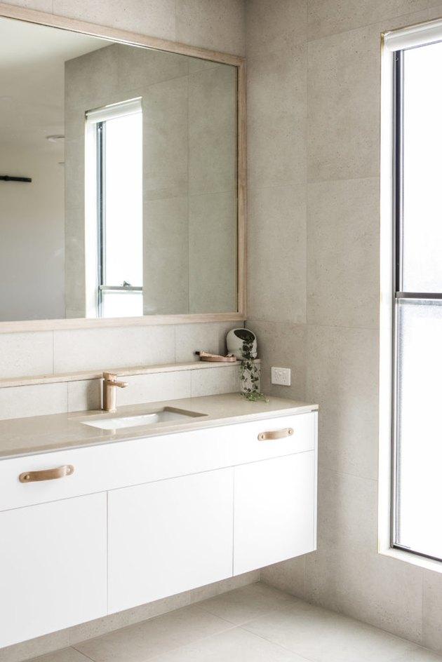 neutral stone tile bathroom