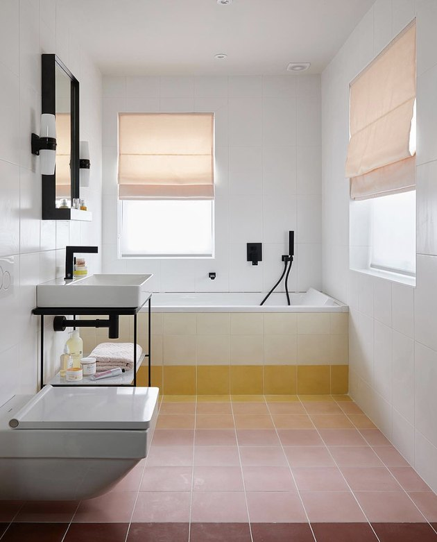 Minimalist bathrooms with terra cotta tile and roman shades