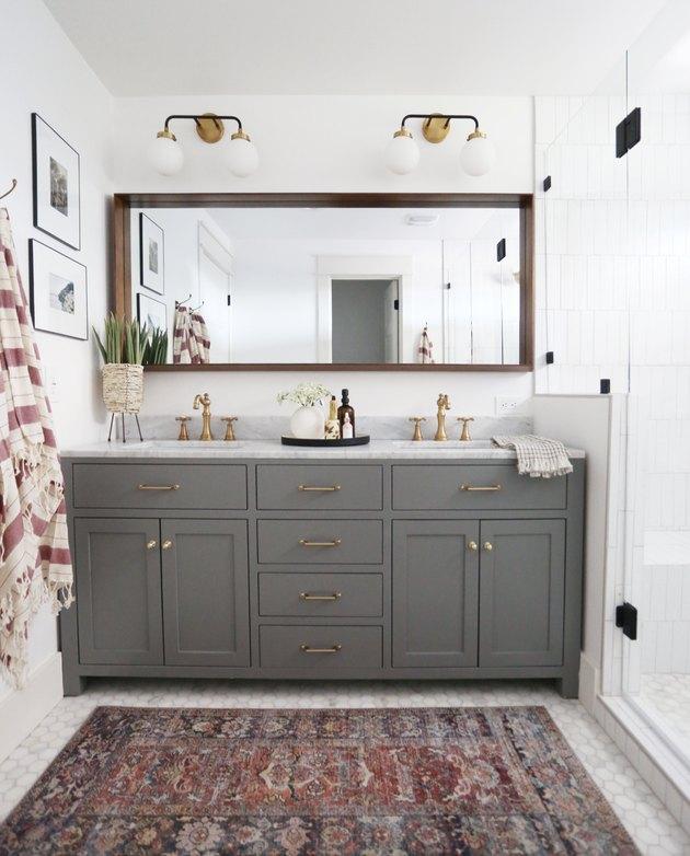 double vanity bathroom wall lighting idea above rectangular mirror