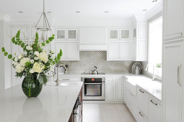 kitchen with white kitchen floor tiles, recessed light. and florals