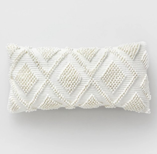 white diamond-pattern outdoor pillow