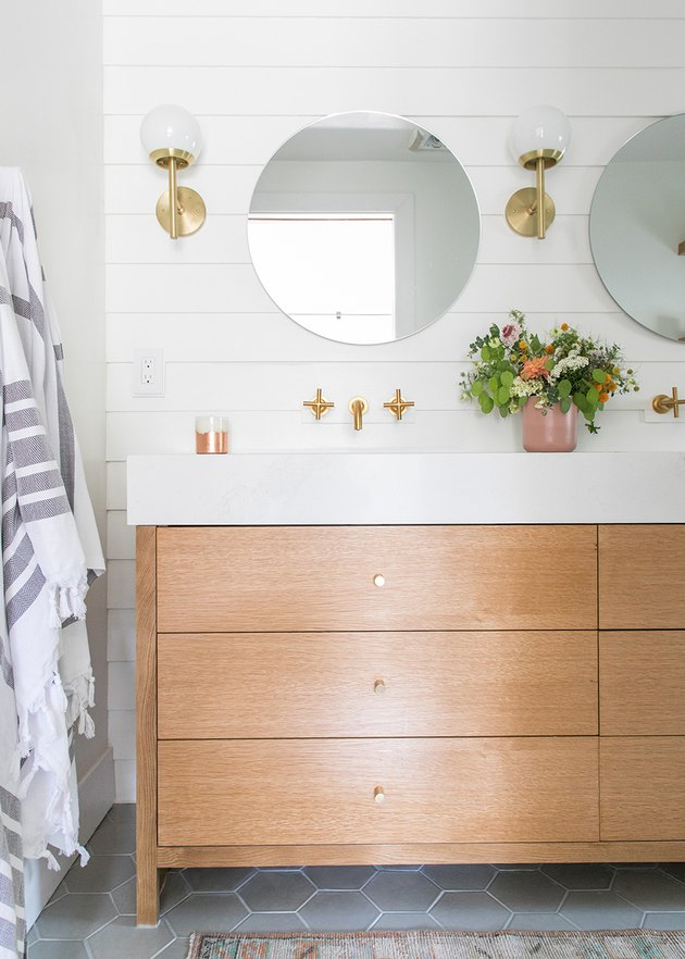 bathroom mirror idea with white bathroom with wooden vanity and frameless mirror